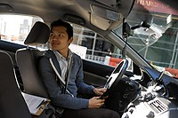 Pin Lu in his taxi (WSJ)